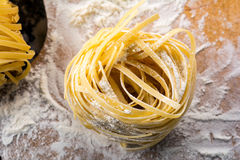Pasta on wooden background Royalty Free Stock Photo