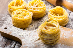 Pasta on wooden background Royalty Free Stock Photography