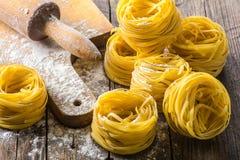 Pasta on wooden background Stock Photo