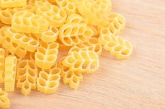 Pasta on wooden background Royalty Free Stock Images