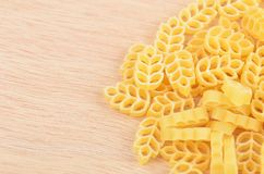 Pasta on wooden background Stock Images