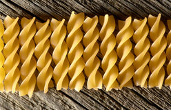 Pasta on the wooden background Stock Photo