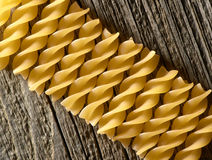 Pasta on the wooden background Royalty Free Stock Image