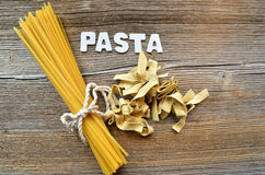 Pasta on wooden background Royalty Free Stock Photos