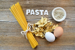 Pasta on wooden background Stock Photography