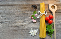 Pasta on wooden background Wooden Spoon Stock Photos