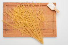 Pasta on Wooden Board with Flour Royalty Free Stock Photo
