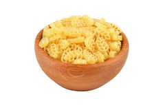 Pasta in wooden bowl Stock Image