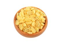 Pasta in wooden bowl Royalty Free Stock Images