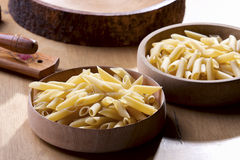 Pasta in Wooden bowl. Main ingredient of pasta in wooden bowl stock image