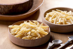 Pasta in Wooden bowl. Main ingredient of pasta in wooden bowl Royalty Free Stock Photo