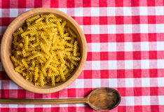 Pasta in wooden bowl Royalty Free Stock Image