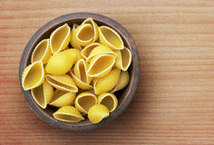 Pasta in wooden bowl Stock Photography