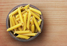 Pasta in wooden bowl Royalty Free Stock Photo