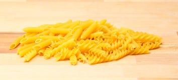 Pasta on a wooden countertop Royalty Free Stock Photos