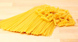 Pasta on a wooden countertop Royalty Free Stock Images