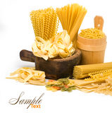 Pasta and wooden plate Royalty Free Stock Image