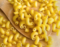 Pasta on wooden spoon. Spiral pasta on wooden spoon Royalty Free Stock Image