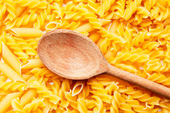 Pasta and wooden spoon Royalty Free Stock Photo
