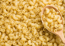 Pasta and wooden spoon Stock Photo