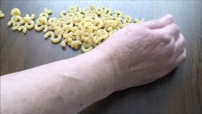 Pasta on wooden table stock video footage