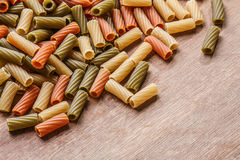 Pasta on wooden table with copyspace. Multicolored pasta on wooden table with copyspace Stock Image