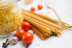Pasta on wooden table Stock Image
