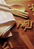 Pasta on wooden table Royalty Free Stock Photography