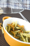 Pasta in yellow bowl Stock Images