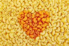 Pasta yellow with an orange heart in the middle Stock Photos