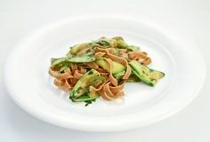 Pasta zucchini. Domestic made tagliatelle pasta with zucchini Stock Photos