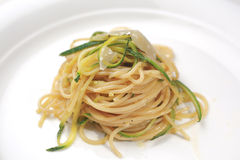 Pasta with zucchini. Traditional italian pasta with courgette on white plate Royalty Free Stock Image