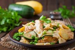Pasta with zucchini, chicken Stock Photo