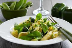 Pasta with zucchini Stock Images