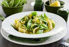 Pasta with zucchini Stock Photos