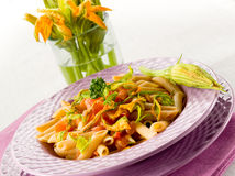 Pasta with zucchinis flower royalty free stock image