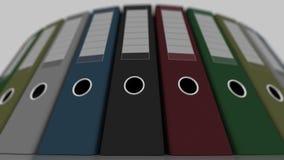 Pastas coloridas do escritório, tiro largo do baixo ângulo, foco raso rendição 3d Foto de Stock Royalty Free