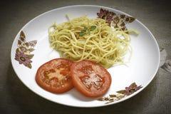 Pastas con el tomatte del ajo y del aceite y del orégano Imágenes de archivo libres de regalías