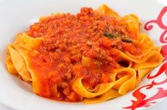 Pastas con la salsa de tomate Fotos de archivo