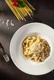 Pastas con las setas y el parmesano Foto de archivo