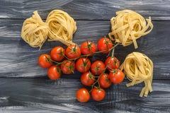 Pastas con los tomates Fotografía de archivo libre de regalías