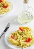 Pastas con los tomates y el aceite de oliva Imagenes de archivo