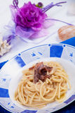 Pastas con mantequilla y anchoas foto de archivo libre de regalías