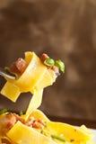 Pastas con tocino Foto de archivo libre de regalías