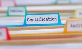 Pastas de arquivos com uma aba etiquetada certificação fotografia de stock royalty free