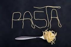 Pastas de la palabra hechas de sapghetti foto de archivo libre de regalías