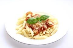 Pastas de Penne con la salsa de tomate Foto de archivo libre de regalías