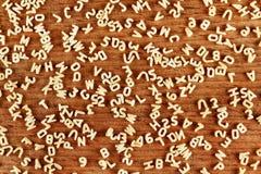 Pastas del alfabeto en el fondo de madera Imagen de archivo
