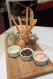 Pastas em uma bandeja de madeira Imagens de Stock Royalty Free