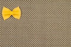 Pastas en fondo amarillento Imágenes de archivo libres de regalías
